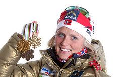 Therse Johaug med medaljer fra VM i Oslo 2011. Foto: Hemmersbach/NordicFocus.