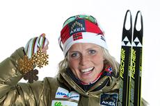 Therese Johaug med medaljer fra VM i Holmenkollen 2011. Foto: Hemmersbach/NordicFocus.
