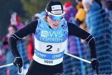 Skiskytter Tora Berger lot børsa ligge og stilte til start for IL Varden i NM-stafetten på Voss 2012. Det ble gull sammen med Kristin Gausen og Marthe Kristoffersen. Foto: Geir Nilsen/Langrenn.com.