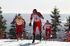 Justyna Kowalczyk. Bak til venstre i bildet følger Marit Bjørgen og deretter Therese Johaug. Foto: Hemmersbach/NordicFocus.