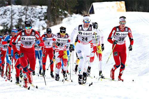 Petter Eliassen, Anders Södergren og Kristian Tettli Rennemo fører an i feltet undet 5-mila i Holmenkollen 2012. Foto: Laiho/NordicFocus.