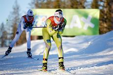 Marit Bjørgen underveis i norgesmesterskapet på 10 km fristil på Gåsbu 2013. Like bak følger Kristin Størmer Steira. Foto: Rasmus Kongsøre/Langrenn.com.