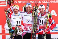 Seierspallen på 15 km under VM i Val di Fiemme 2013. Fra venstre: Johan Olsson (nr. 2), Petter Northug jr. (1) og Tord Asle Gjerdalen (3). Foto: Laiho/NordicFocus.