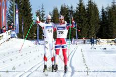 Hans Christer Holund og Øystein Pettersen går inn til bronse på 5-mila under NM på Budor 2013. Foto: Erik Borg.