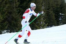 Hans Christer Holund ute på 5-mila under NM på Budor 2013. I mål ble det delt 3. plass med Øystein Pettersen. Foto: Erik Borg.