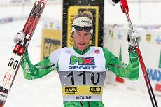 Simen Østensen jubler etter å ha tatt gull på 15 kilometer klassisk under NM i Lillehammer 2014. Foto: Geir Nilsen/Langrenn.com.
