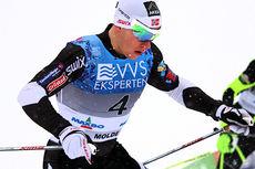 Anders Nøstdahl Gløersen på vei mot 4. plass i NM-sprinten på Lillehammer 2014. Men med britisk vinner gjennom Andrew Musgrave ble det  bronse til Rustad-løperen. Foto: Geir Nilsen/Langrenn.com.
