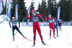 Mattis Stenshagen går i mål som vinner av 17-årsklassen på 10 km skiathlon under NM del 2 på Budor 2013. Foto: Erik Borg.