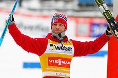 Martin Johnsrud Sundby økte sin sammenlagtledelse i verdenscupen etter  seier på 15 kilometer i Lahti 2014. Foto: Laiho/NordicFocus.