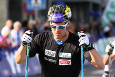 Øystein Pettersen varmer opp under Toppidrettsveka 2014. Foto: Geir Nilsen/Langrenn.com.