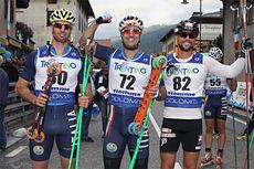 Topp 3 på sprinten under verdenscupen på rulleski i Val di Fiemme 2014. Fra venstre: Emmanuele Sbabo (2), Alessio Berlanda (1) og Ludvig Søgnen Jensen (3). Foto: Newspower.it.