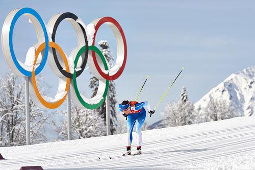 Aino-Kaisa Saarinen underveis på lagsprinten i Sotsji-OL 2014. Foto: NordicFocus.