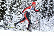 Anders Aukland gikk seg inn til en sterk 7.-plass på 15 km klassisk under Beitosprinten 2014. Han har sin fokus i sporet, mens manageren tar seg av papirarbeidet. Foto: Erik Borg.