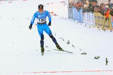 Martin Johnsrud Sundby krysser målstreken til seier på 15 km fri under Beitosprinten 2014. Foto: Erik Borg.