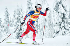 Marit Bjørgen underveis i verdenscupåpningens 10 km i klassisk stil i Kuusamo 2014. Foto: Felgenhauer/NordicFocus.