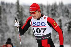 Andreas Nygaard på vei opp danskebakken under Beitosprintens 15 km klassik 2014. Foto: Geir Nilsen/Langrenn.com.