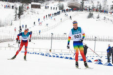 Gaute Kvåle fra Hovden Skigymnas vinner her 20 km skiatlon foran Ole Jørgen Bruvoll under juniorenes VM-mønstring på Lillehammer nå i desember 2014. Foto: Erik Borg.