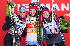 Topp tre på damenes 10 km fri under verdenscupen i Davos 2014. Fra venstre: Nicole Fessel (2), Marit Bjørgen (1) og Heidi Weng (3). Foto: Laiho/NordicFocus.