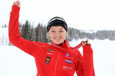 Martine Lorgen Øvrebust med gull fra junior-NM på Mo i Rana 2014. Foto: Erik Borg.