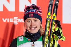 Ragnhild Haga smiler fornøyd etter å ha sikret seg 3. plass i sprintfinalen under minitouren i Kuusamo og Ruka 2015. Foto: Modica/NordicFocus.