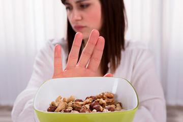 bs-Woman-Refusing-NutFood-235889101-400