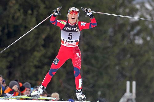 Therese Johaug, Tour de Ski målgang siste etp. Val di Fiemme 2011. Foto: Hemmersbach/NordicFocus.