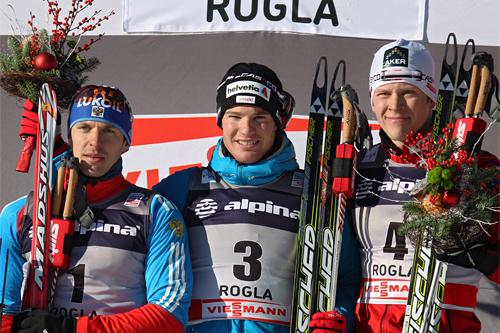 Seierspallen i herrenes sprint i verdenscupen 2011. Fra venstre: Nikolay Morilov (2), Dario Cologna (1) og Anders Gløersen (3). Foto: Hemmersbach/NordicFocus.