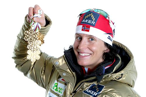 Marit Bjørgen med medaljefangsten fra VM i Oslo og Holmenkollen 2011. Foto: Hemmersbach/NordicFocus.