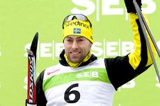 Jörgen Brink på seierspallen etter å ha vunnet Tartu Maraton 2012. Foto: Laiho/NordicFocus.