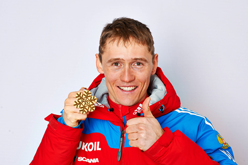 Nikita Kriukov med VM-gullet på sprinten i Val di Fiemme 2013. Foto: Felgenhauer/NordicFocus.