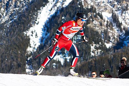 Marit Bjørgen underveis i prologen under sprinten i Lenzerheide, 3. etappe av Tour de Ski 2013/2014. Foto: Felgenhauer/NordicFocus.