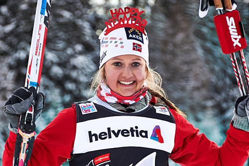 Ingvild Flugstad Østberg etter seieren i 3. etappe av Tour de Ski 2013/2014. Det var sprint i fri teknikk som sto på programmet i Lenzerheide på selveste nyttårsaften. Foto: Felgenhauer/NordicFocus.