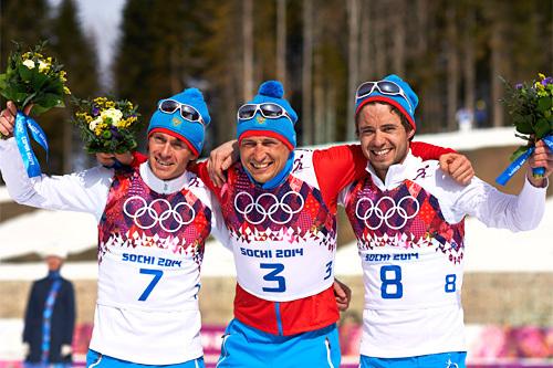 Seierspallen på den avsluttende 5-mila under Sotsji-OL 2014. Fra venstre: Ilia Chernousov (2. plass), Alexander Legkov (1) og Maxim Vylegzhanin (3). Foto: NordicFocus.