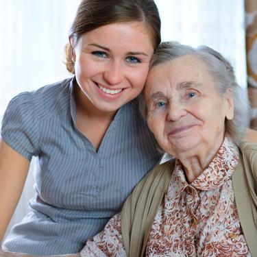 Kvinne sammen med eldre dame illustrasjonsfoto
