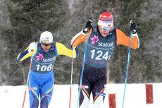 Pål Golberg foran Petter Northug i det tette snødrevet på semifinalen i lagsprint under NM på Beitostølen 2016. Foto: Erik Borg.
