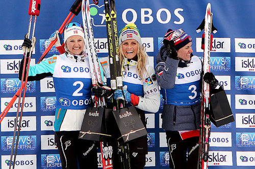 Seierspallen på 5 km fri for kvinner under NM på Beitostølen 2016. Fra venstre: Ingvild Flugstad Østberg (2.-plass), Therese Johaug (1) og Heidi Weng (3). Foto: Erik Borg.