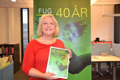 Gunn Iren Müller med 40 års-plakat