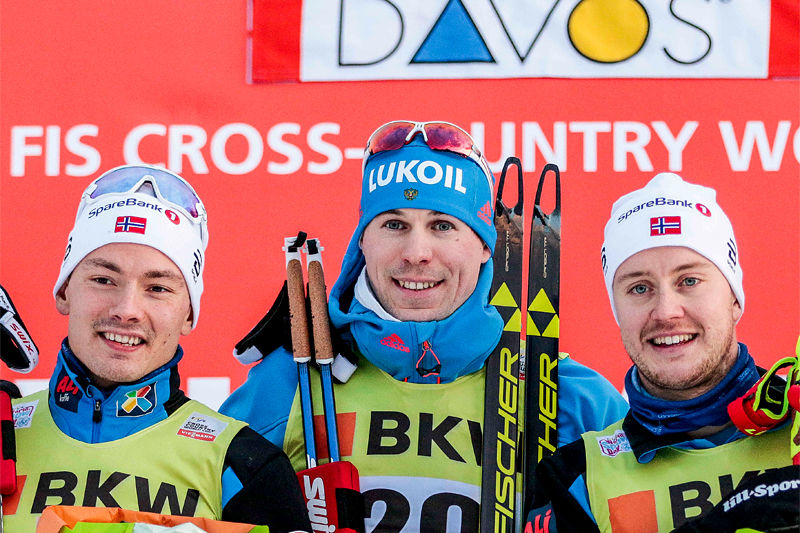 Herrenes seierspall i Davos-sprinten forrige vinter. Fra venstre: Finn Hågen Krogh (2. plass), Sergey Ustiugov (1) og Sindre Bjørnestad Skar (3). Foto: Modica/NordicFocus.