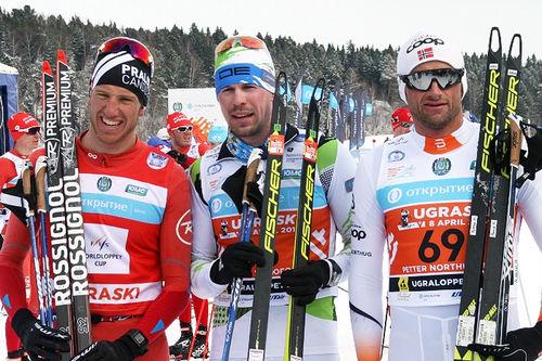 Topptrioen i Ugra Ski Marathon 2017. Fra venstre: Candide Pralong (3. plass), Sergey Ustiugov (1) og Petter Northug (2). Foto: Andrey Kascha.