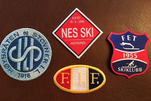 Logoer Nes Ski, Fossum IF, Fet SK og Høybråten & Stovner IL.