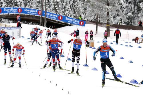 Martin Johnsrud Sundby avgjør 30  km skiathlon under NM på Gåsbu 2018 til sin fordel. Nærmest følger Niklas Dyrhaug og Finn Hågen Krogh. Foto: Erik Borg.
