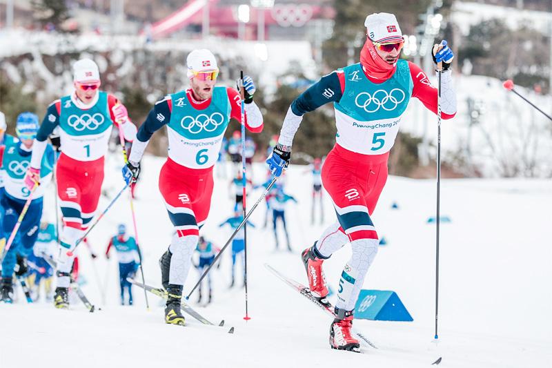 OL-skiathlon i Pyeongchang 2018. Hans Christer Holund fører an foran Martin Johnsrud Sundby og Johannes Høsflot Klæbo. I mål var de to førstnevnte nummer 3 og 2. Foto: Modica/NordicFocus.