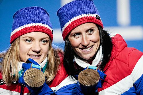 Maiken Caspersen Falla (t.v.) og Marit Bjørgen tok Norge inn til OL-bronse på lagsprinten i Pyeongchang 2018. Foto: Modica/NordicFocus.