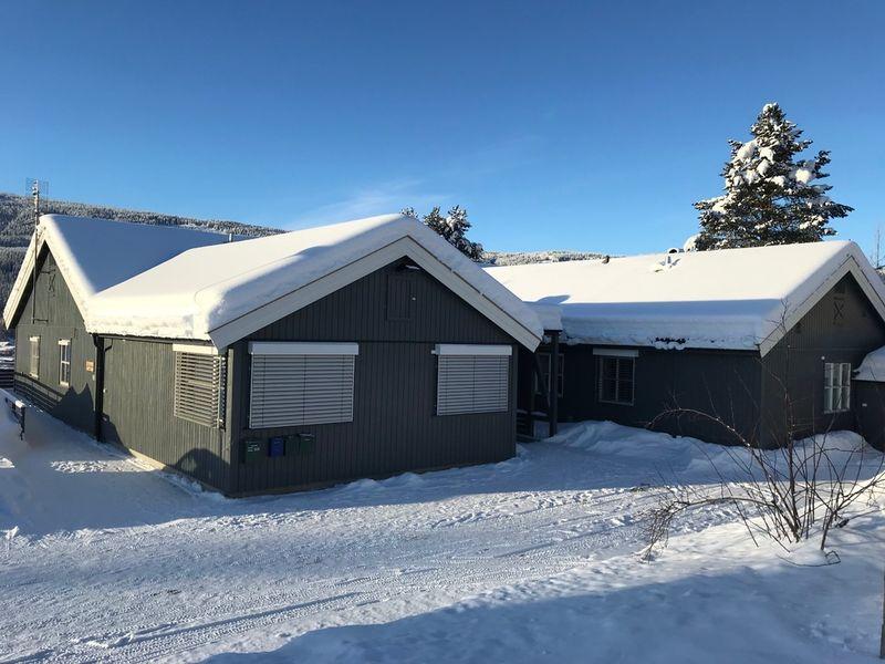 Bilde av Flatland bofellesskap utendørs i vinterlandskap